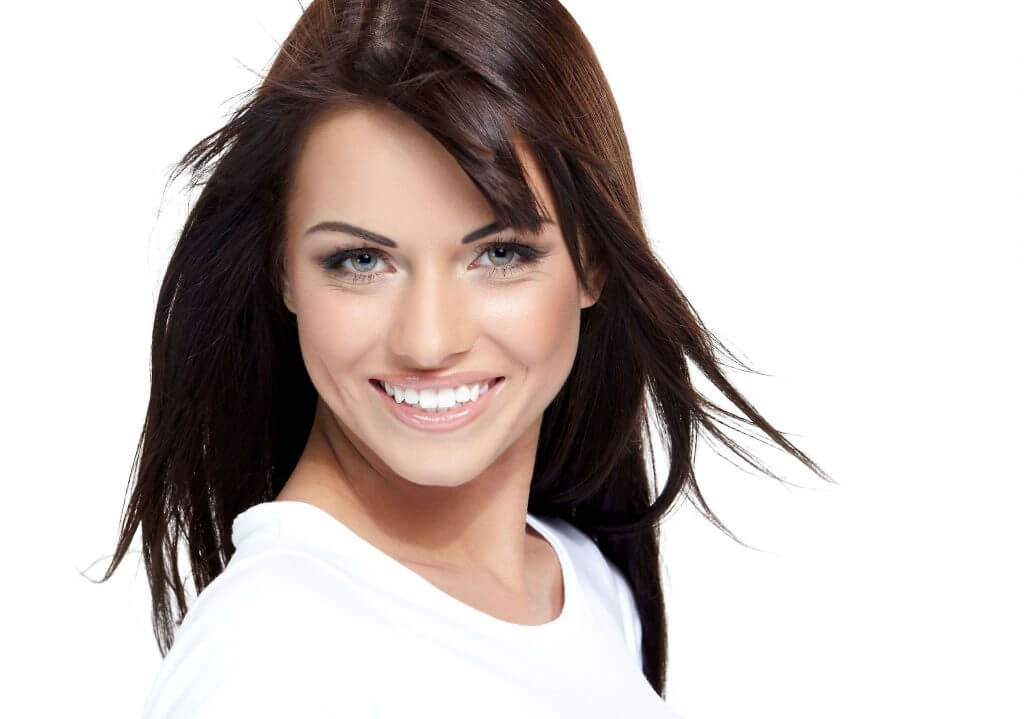 photo of woman with cerec crown smiling at the camera