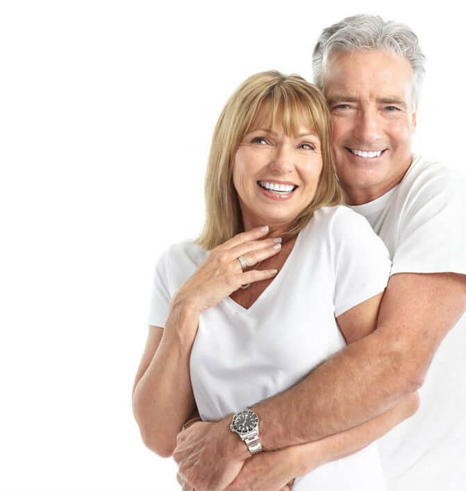 photo of an older couple embracing and smiling to show their cosmetic dentures