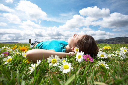 woman laying in a field of flowers